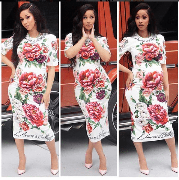 Rapper Cardi B wears a red, white, and pink floral dress.